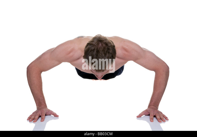 Man doing a press up isolated on a white background - Stock Image