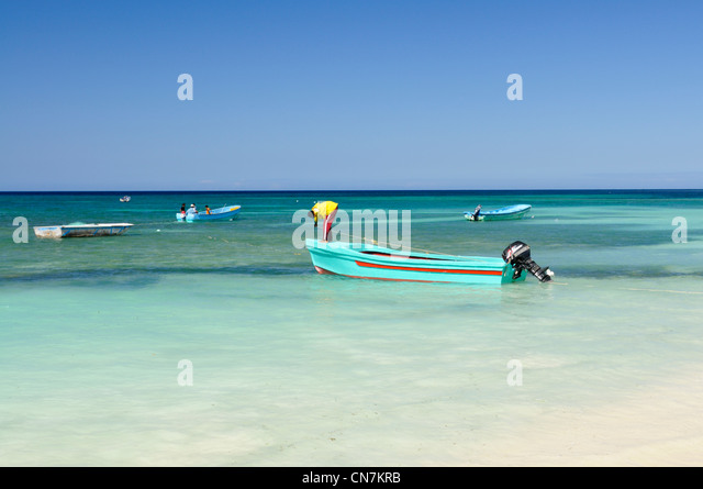 Dominican Republic, Puerto Plata province, Punta Rucia, fishing boats and beach at Punta Rucia (Punta Rusia) - Stock Image