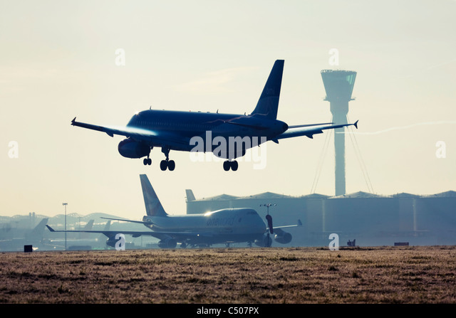 Airplane landing at London Heathrow Airport. - Stock Image
