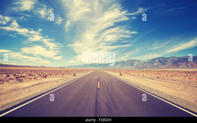 Vintage style country highway in USA, travel adventure concept. - Stock Image