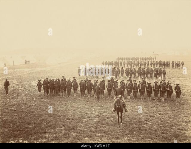 African American soldiers in formation at Camp Meade, Pennsylvania, May 1899. African Americans, most from the southern - Stock Image
