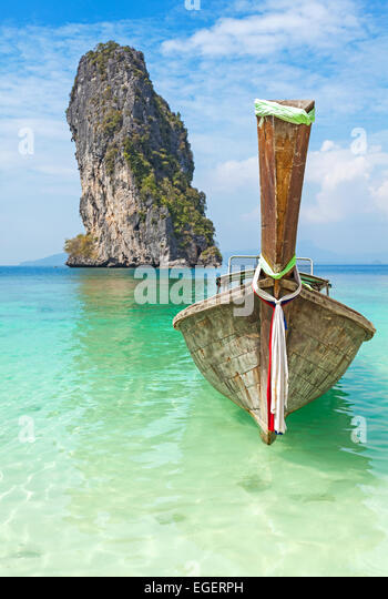 Old wooden boat on a tropical island. - Stock Image