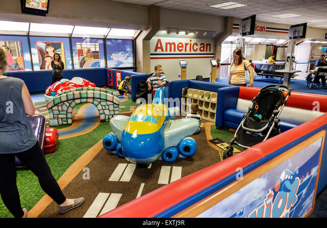 Dallas Texas Dallas Ft. Fort Worth International Airport DFW American Airlines terminal concourse children play - Stock Image