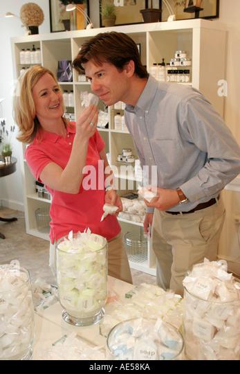 Leesburg Virginia West Loudoun Street Creme de la Creme couple shopping soaps - Stock Image