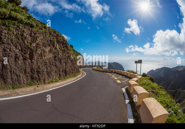 Mountain Pass Road with Sun, Teno Mountains, Masca, Tenerife, Canary Islands, Spain - Stock Image