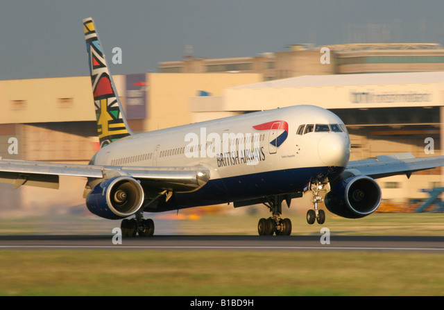British Airways Boeing 767 touching down at London Heathrow Airport United Kingdom - Stock Image