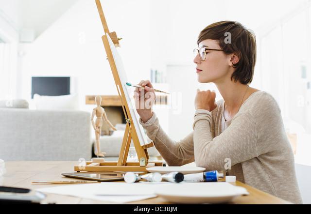 Woman Painting At Easel Stock Photos & Woman Painting At ...