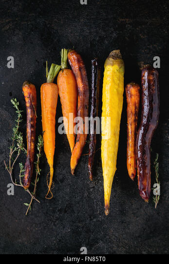 Baked colorful carrots - Stock Image