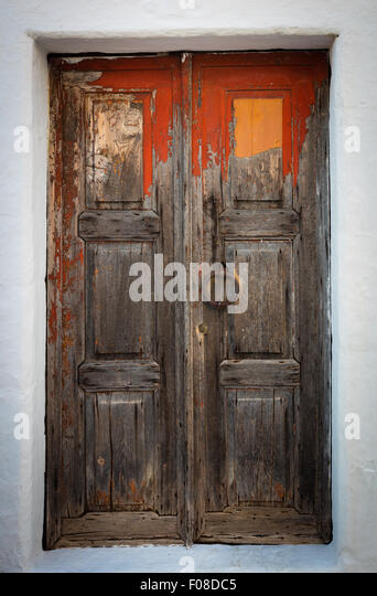 Old door in the town of Chora on Patmos island in Greece. - Stock Image
