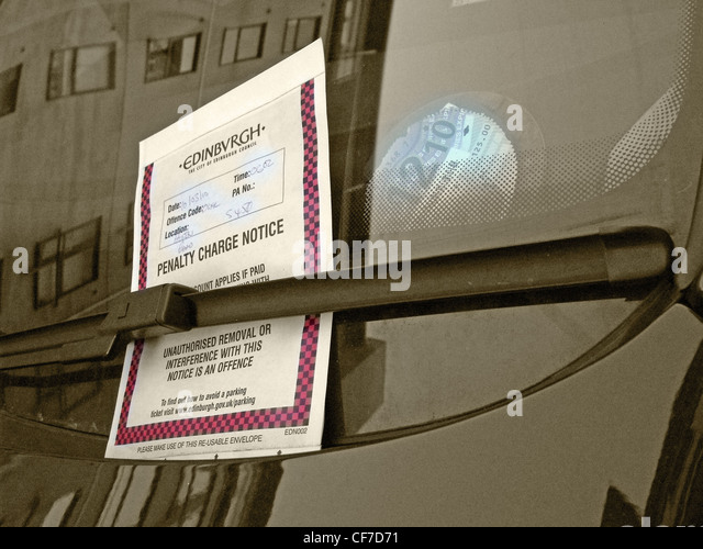 Edinburgh parking ticket on a car under a windscreen wiper in Hulton Road, Holyrood, Edinburgh, Scotland, UK - Stock Image