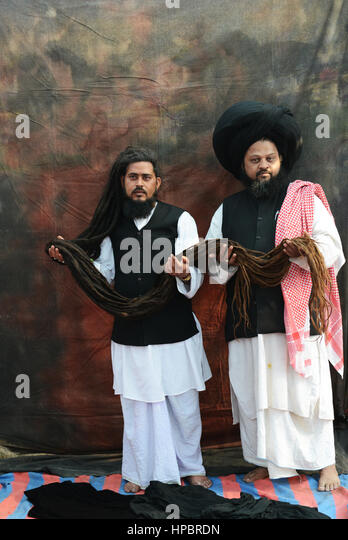 Thirty year long hair. Sufi Malangs showing their long hair. - Stock Image