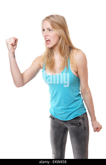 angry woman with clenched fist - Stock Image