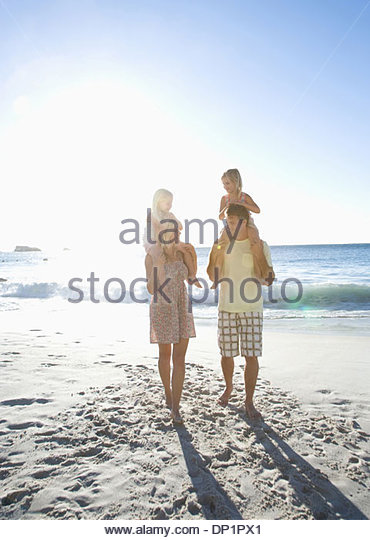 Family on beach - Stock Image