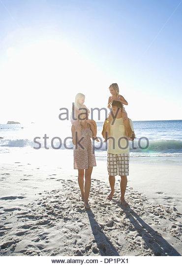 Family on beach - Stock-Bilder