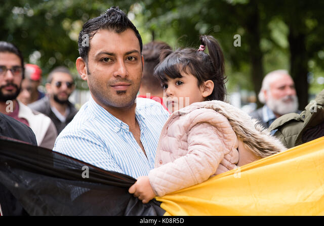Brussels, Belgium. 21st Aug, 2017. Iraqi refugees protest at the office for refugees in Brussels for asylum and - Stock Image
