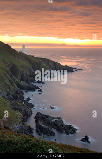 Spectacular sunrise behind Start Point Lighthouse in South Hams, Devon, England. Autumn (September) 2010. - Stock Image