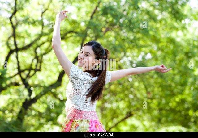 Confident Young Woman at the Park - Stock Image