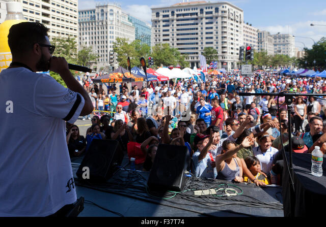 Hip-hop performer on stage at an outdoor concert - USA - Stock Image