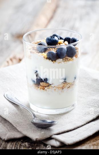 Natural yogurt with fresh blueberries, selective focus - Stock Image
