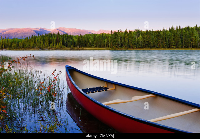 Artist's Choice: Canoe and Boya Lake at sunset, Boya Lake Provincial Park, Northern British Columbia - Stock Image