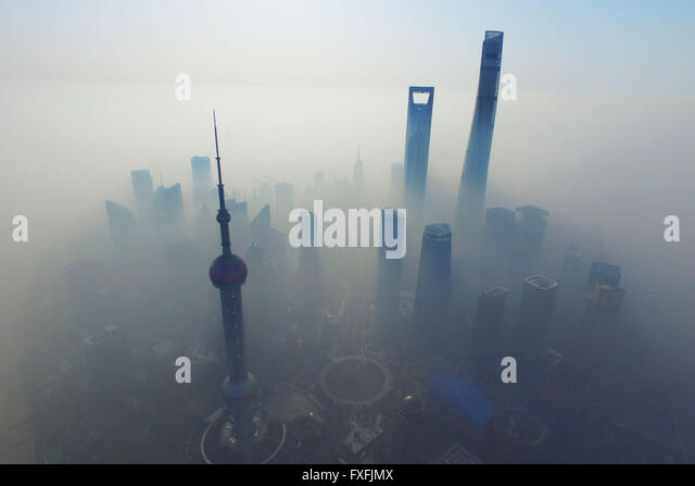 Shanghai, Shanghai, CHN. 14th Apr, 2016. Air pollution hits Shanghai and Skyscrapers are gone in the fog. Suburban - Stock Image
