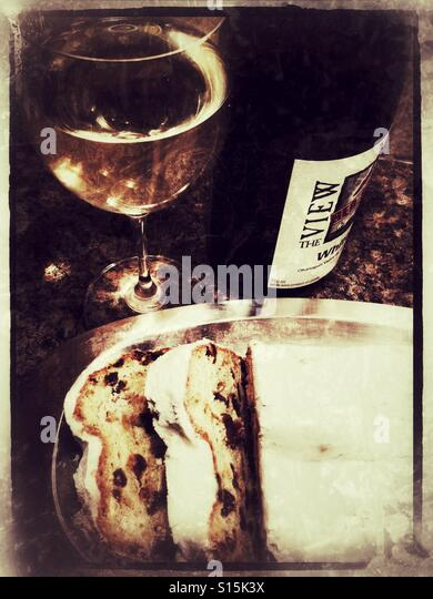 Stollen and white wine. - Stock Image