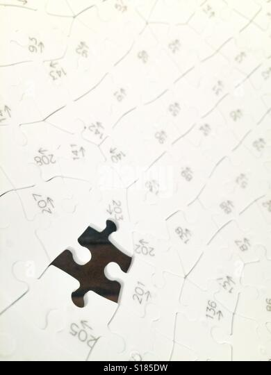 The missing piece of a jigsaw - Stock Image