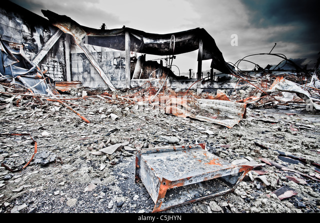A closed down industrial site with lot of junk and decayed objects. - Stock Image