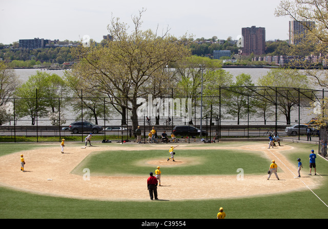 View of boys little league baseball field with game in progress. - Stock Image