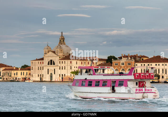 'Pink Venice' passing by  Giudecca island. - Stock Image