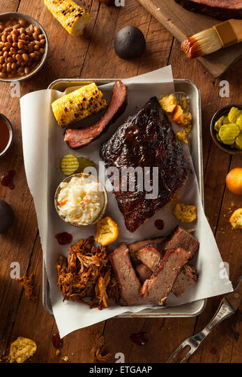 Barbecue Smoked Brisket and Ribs Platter with Pulled Pork and Sides - Stock Image