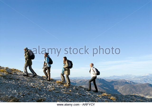 4 people on a trek - Stock Image