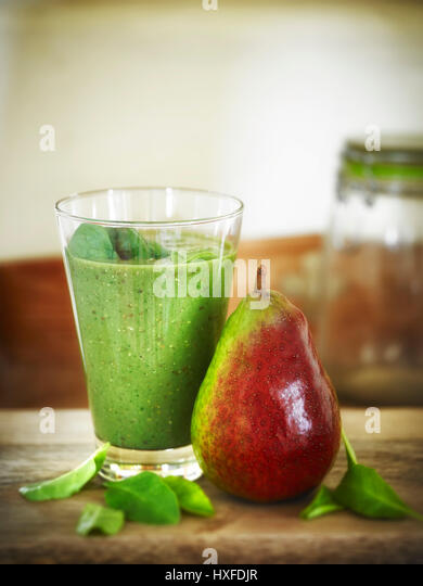 Healthy pear spinach and quinoa detox breakfast smoothie - Stock Image