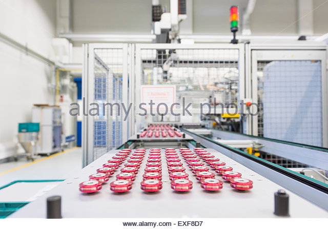 Rows of products on factory production line - Stock Image