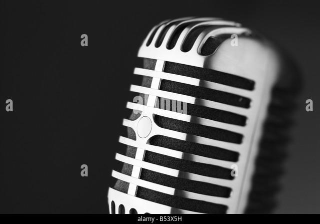 Classic retro microphone on black background selective focus - Stock-Bilder