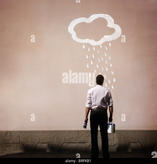 man with rain cloud painted on a wall - Stock-Bilder