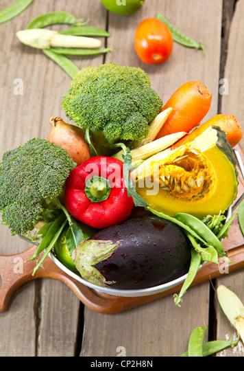 Varieties of vegetables in colander - Stock Image