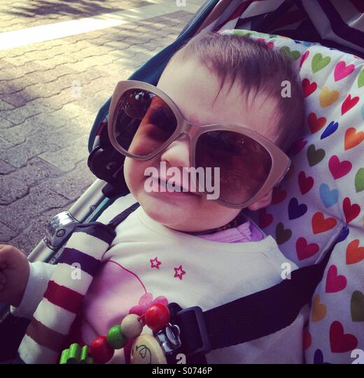 Baby girl posing with moms glasses - Stock-Bilder