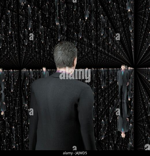 A man standing in a small room or cubicle where all six surfaces are mirrors. Computer artwork. - Stock-Bilder