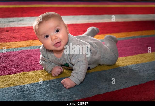 Newborn boy on the carpet - Stock-Bilder