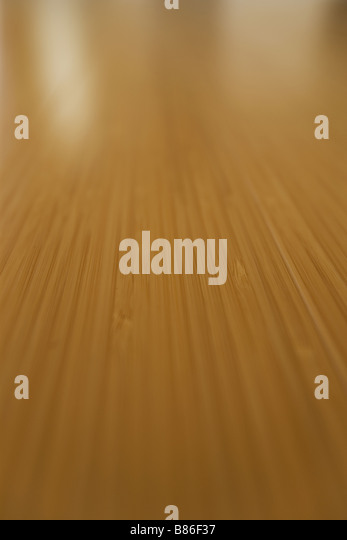 Selective focus of bamboo flooring with window light - Stock Image
