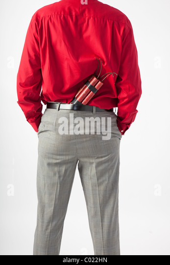 back of man with TNT or dynamite hidden in back of pants, he has his hands in pockets. - Stock Image