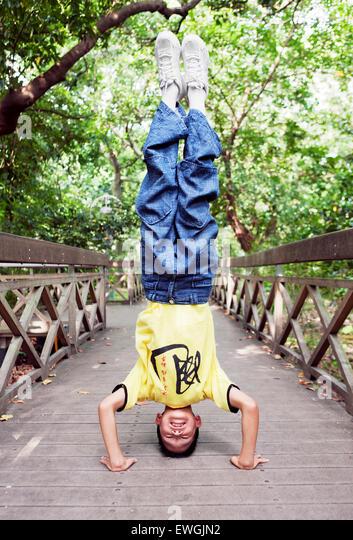 Qigong Student doing a hand stand. Taipei Taiwan - Stock Image
