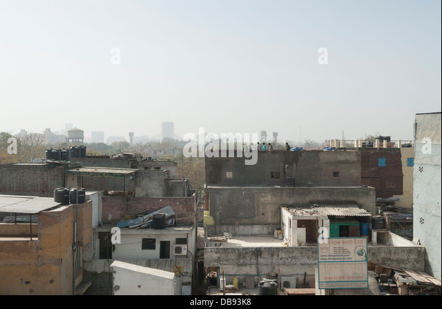 Paharganj, Delhi, India. 23rd March 2012. Delhi skyline looking over resident rooftops. - Stock Image