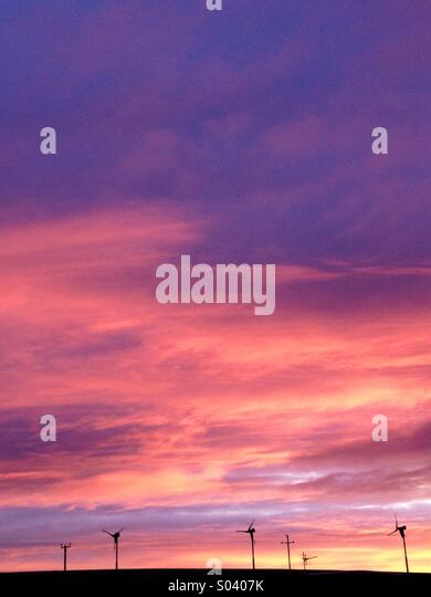 Wind Turbines & Sunrise. - Stock Image
