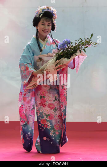 Geisha ready for performing an ikebana ceremony at the Oriental festival in Turin,Italy - Stock Image