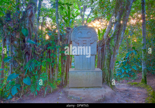 Ancient statue in rain forest, San Agustin Archaeological Park, Colombia, 3000 year statues from unknown culture - Stock Image