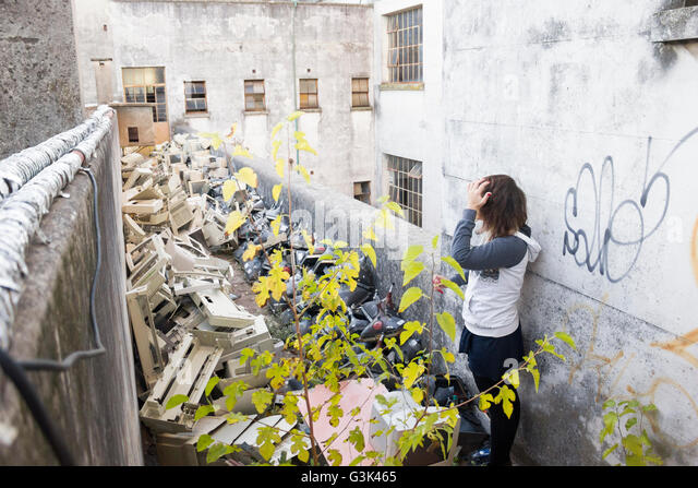 Young girl looking at the electronic disposal on the floor of the school - Stock Image
