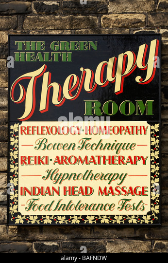 ALTERNATIVE HOMEOPATHIC MEDICINE SHOP SIGN - Stock Image