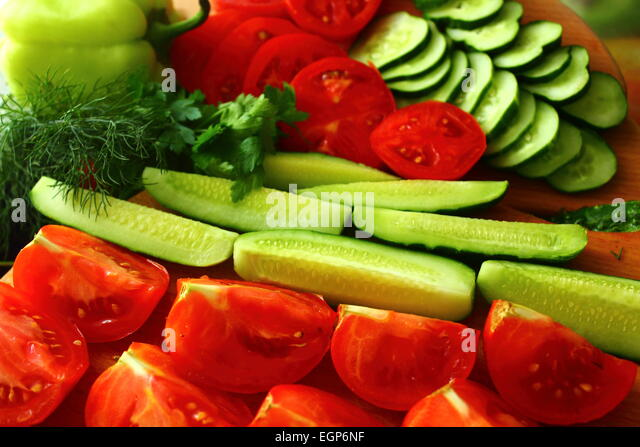 are beautifully fresh tomatoes and cucumbers to eat - Stock Image